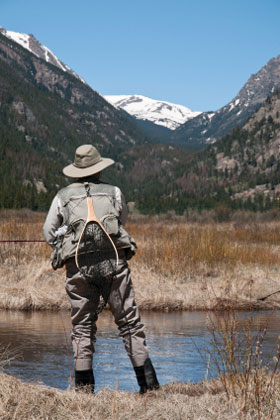 Woman Fly-Fishing in Rocky Mountains